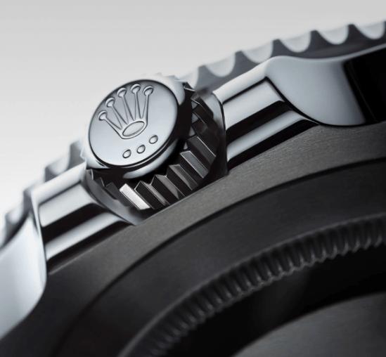 Corona del reloj Rolex en color plateado con la figura de una corona
