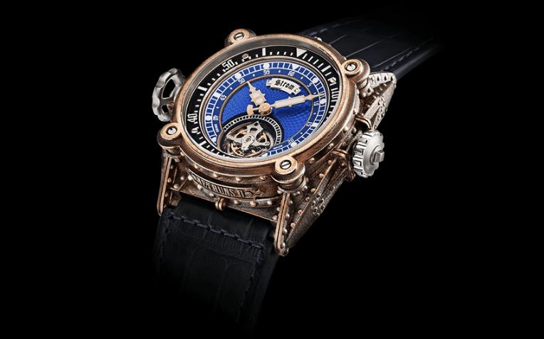 Reloj con correas negras y caratula en color dorado con detalles en color plata, azul, negro y blanco