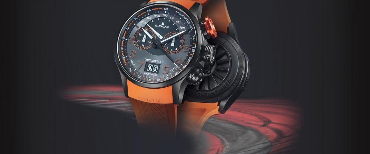 Reloj Chronorally con correas en color naranja y caratula en color negro con detalles en blanco y naranja