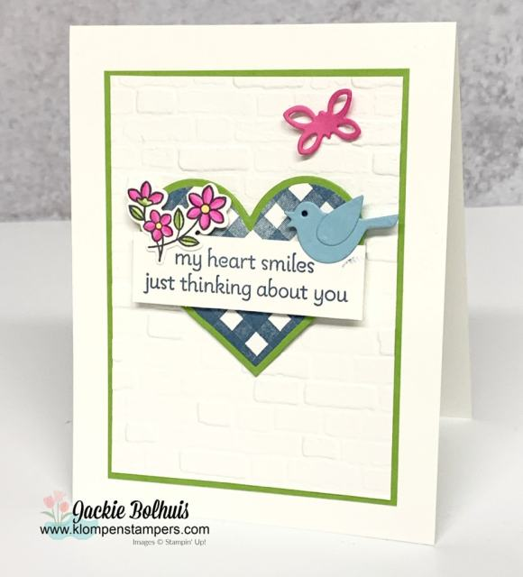 This cute greeting card has a blue gingham heart layered on green cardstock with die cut blue bird.