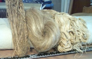 On the left are flax stalks, center are flax fibers, and right is the resulting thread after it has been spun many times.