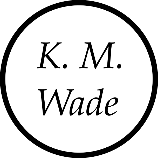 K. M. Wade logo which consists of the words K. M. Wade inside a circle