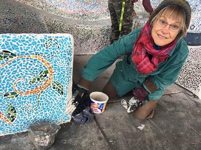 Bonnie Dillard works on mosaic bench. Kayla Desroches/KMXT