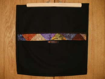 back side with multi-coloured zipper cover