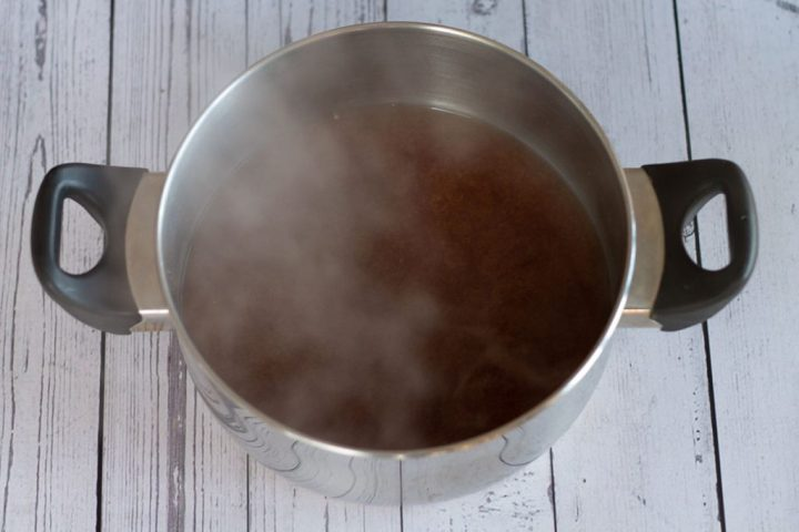 miso and soy broth in saucepan