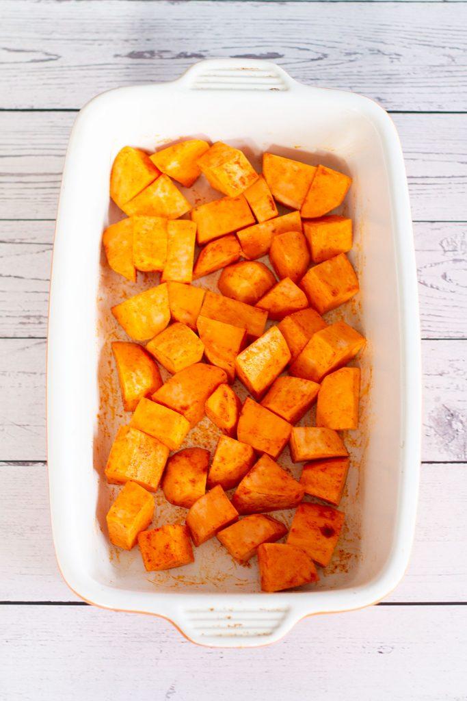 chopped sweet potato in a roasting dish
