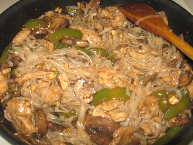Trader Joe's Thai Noodles w/ Peanut Sauce; I added chicken, mushrooms, green bell pepper, and peanuts.  I was surprised b/c Dad LIKED it!