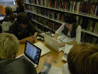 Friends gather to work in the library.
