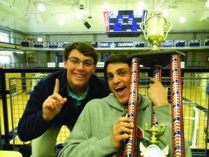Players Danny Kaplan and Zachary Kerker are shown with the World Championship Trophy