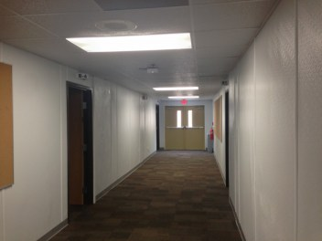 The wide hallways are better for traffic flow, but the walls could use some decoration