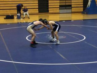 Michael Sloman (right) makes a grab for his opponent