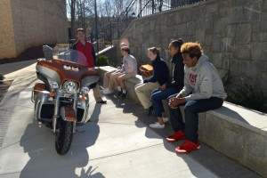 Mr. Sokolsky teaches students about his motorcycle. Photo: Caitlin Jones