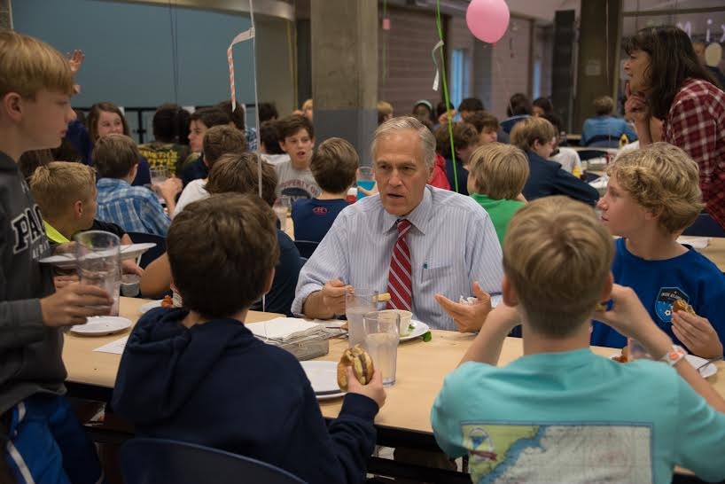 Mr. Anderson joins middle school students at lunch. Photo: Laura Inman