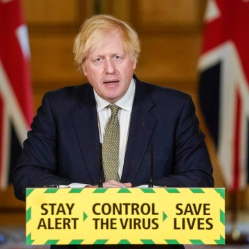 UK PM defends top aide over lockdown breach, announces schools to partially reopen