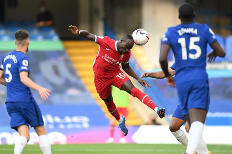 Football: Mane double eases Liverpool to 2-0 win over 10-man Chelsea