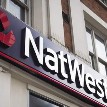 NatWest to cut banker bonus pool as it reports £351m loss