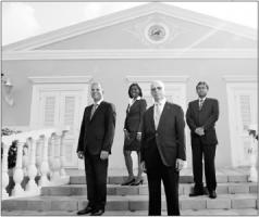 Vlnr. Stephen Capella, Rochelle Monte, Eric Garcia en Richard Rajack. Deze foto stond in de jaarrekening van de bank van 2012. FOTO GIROBANK