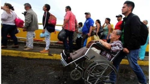 Tens of thousands of Venezuelans queued to cross the bridge into Colombia, and again on their return