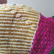 """Detail shot of the tiny """"brioche buds"""" next to the lace wedge"""