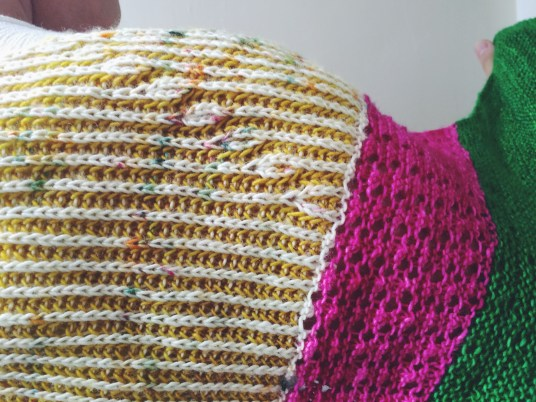 "Detail shot of the tiny ""brioche buds"" next to the lace wedge"