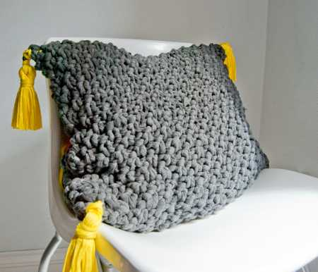 Knit a funky pillow using fabric as yarn.