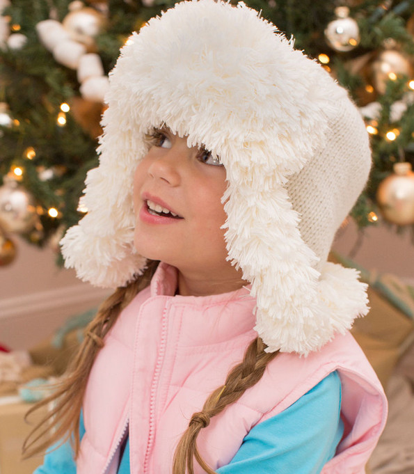 Knit a fun, fur-trimmed earflap hat in three sizes.