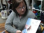 Nancy receiving her winning book, Knitted Gifts