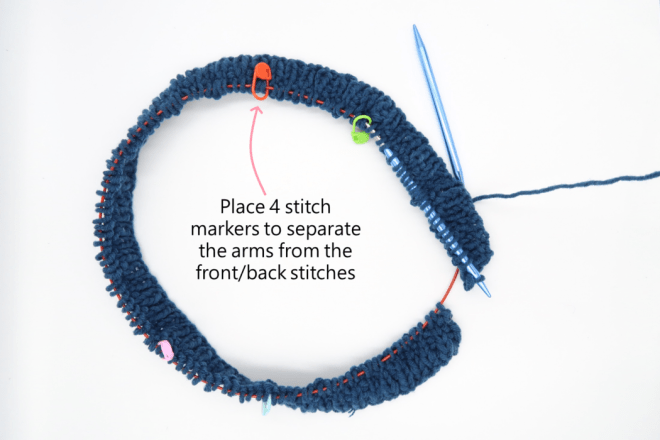 Place stitch markers to help you know when to increase to make the raglan sweater knitting pattern