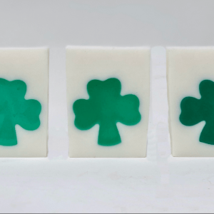 Green shamrock in white soap