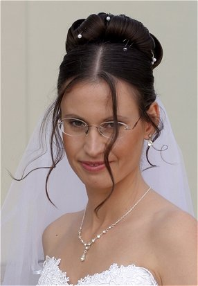 bridal hairstyle mid part updo with bangs knot for life