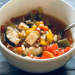 gluten free, vegan vegetable rice soup in a bowl on a wood table