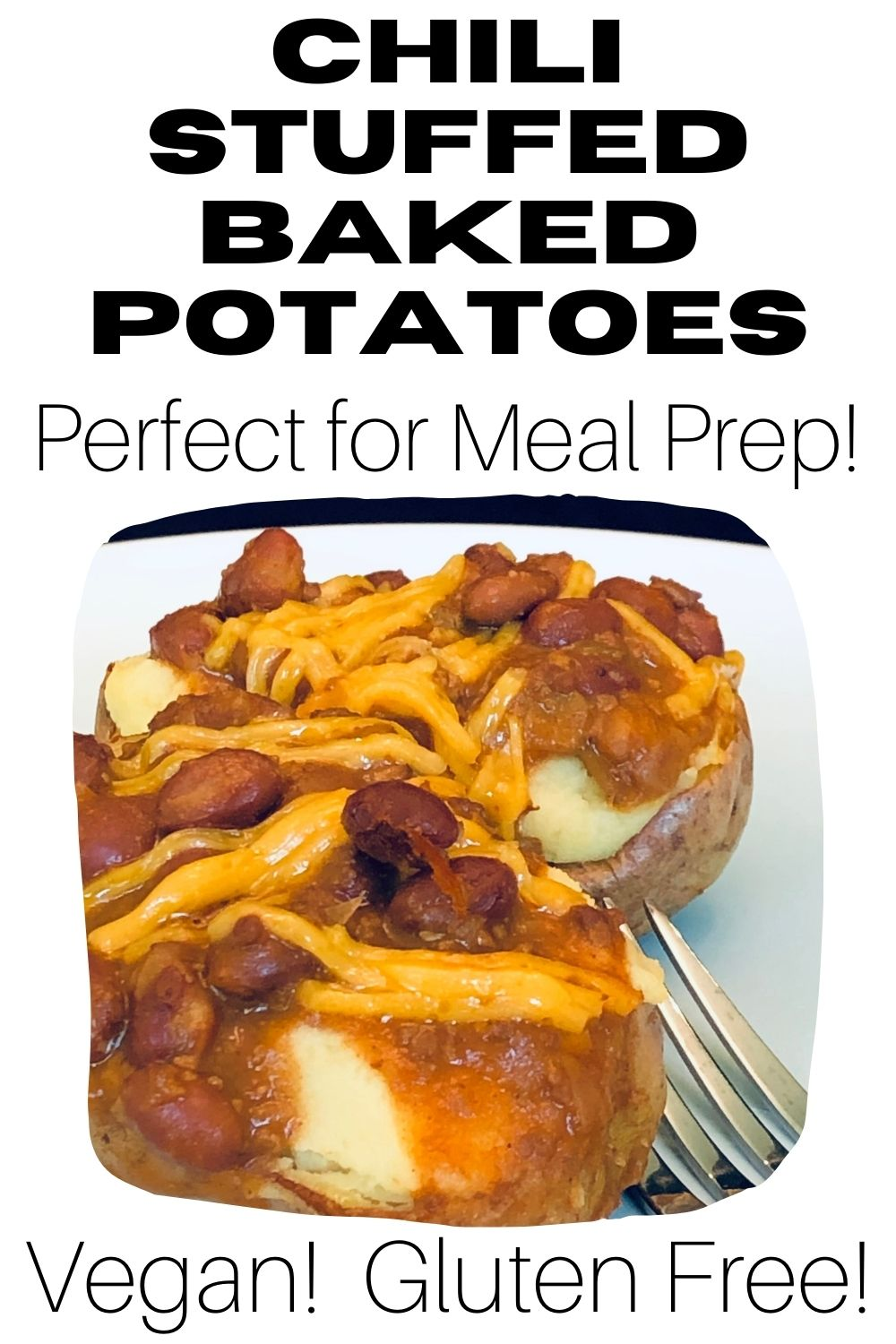 Gluten Free Chili Stuffed Potatoes on a white plate with fork.