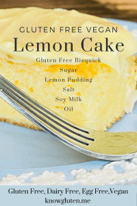 A piece of Gluten Free Lemon Cake on a blue plate with a fork beside it.
