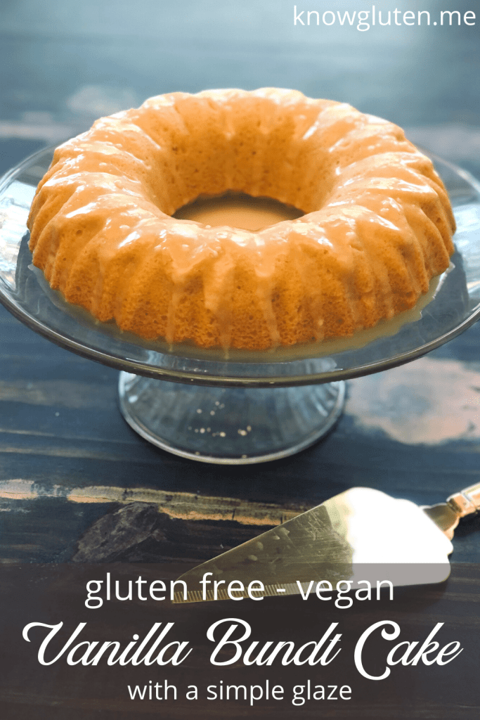 Gluten Free Vanilla Bundt Cake on a serving tray on a wood table with a gold cake server.