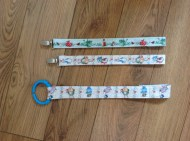 Front view of tags - these hold toys onto the buggy, so Farris won't be able to throw them out!