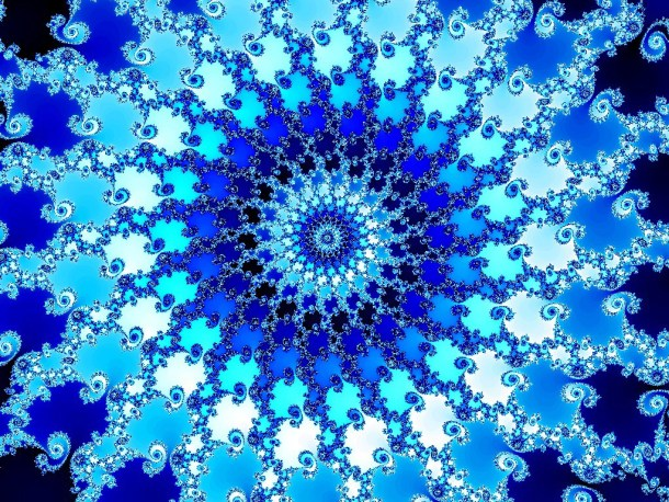 Above is an image of the Mandelbrot set, a geometric pattern discovered by Benoit Mandelbrot that is useful for visualizing the concept of scale invariance.