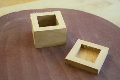 Sanding lid box interface