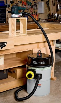 Numatic NVD750 Workshop Vacuum Extractor in use with power tools