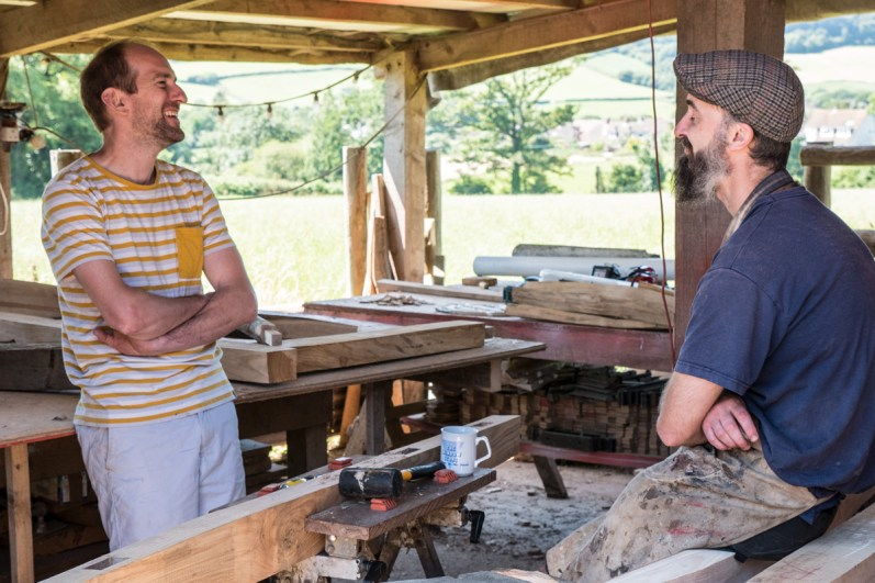 Ed and Mark of Ed Brooks Furniture discussing a project