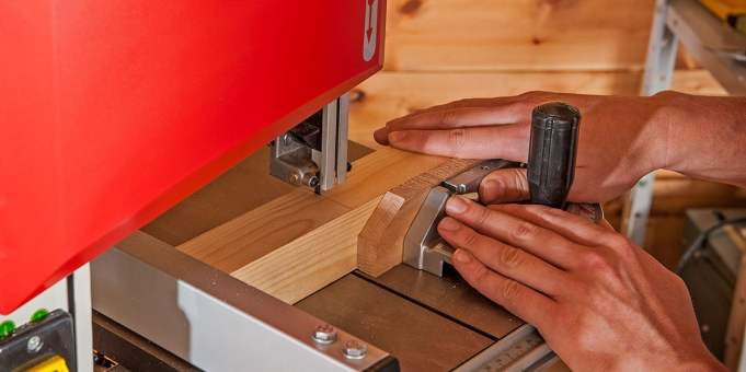 Bandsaw in use with optional mitre fence