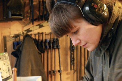 Woodworking with ear defenders on