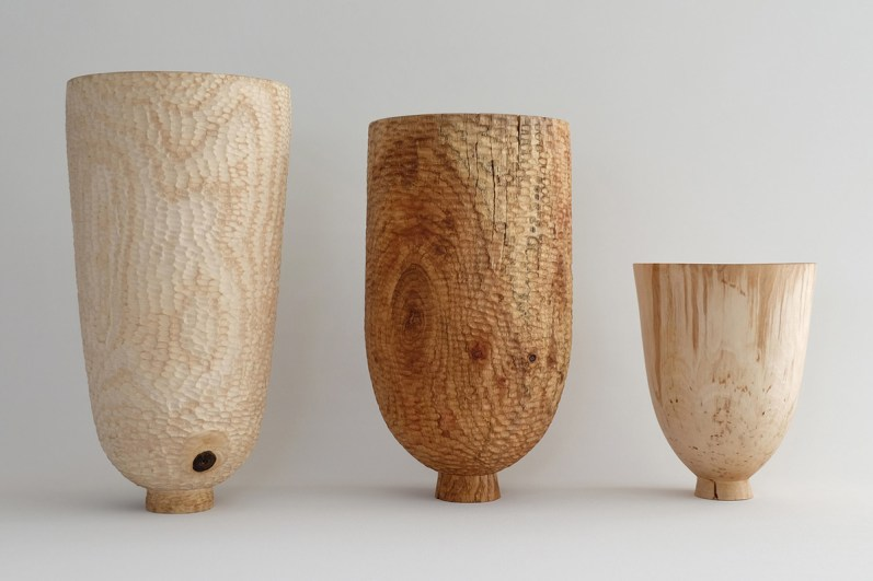 three turned vessels in exhibition