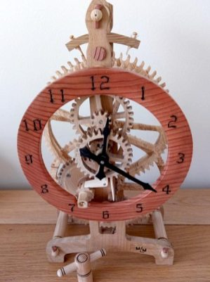 Wooden clock made from recycled Oak and Spalted Beech. Driven by a clock main spring, hand wound (Mike M)
