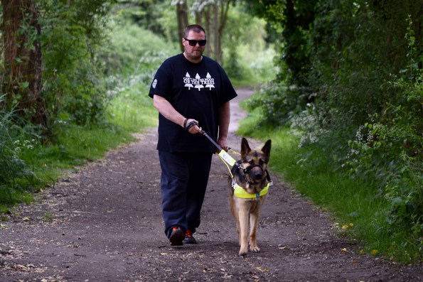 Chris with his guide dog