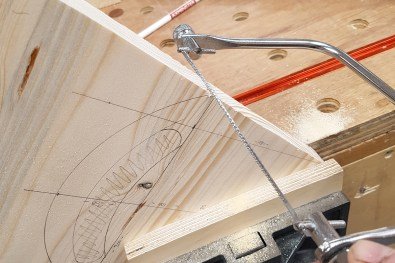 Using a coping saw, form the top of the caddy end