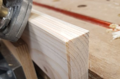 Use a low angle block plane to put small bevels on the outside faces of the rails