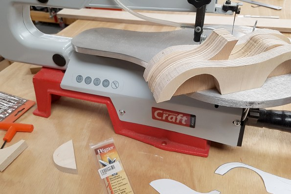 Cutting the car parts with a scroll saw