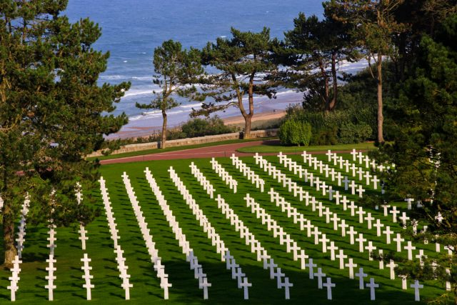 Graves of the fallen with Omaha Beach in the background at the Normandy American Cemetery and Memorial, September 27, 2013, Colleville-sur-Mer, France (Warrick Page/American Battle Monuments Commission) spectator.org