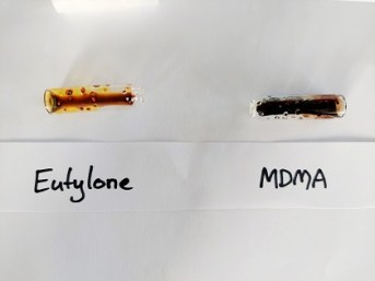 Image showing the results of the Narcocheck reagent test for cathinones. It goes dark yellow-brown in the presence of eutylone and dark blackish purple in the presence of MDMA