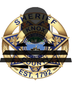 KCSO badge with inmate silhouette overlay